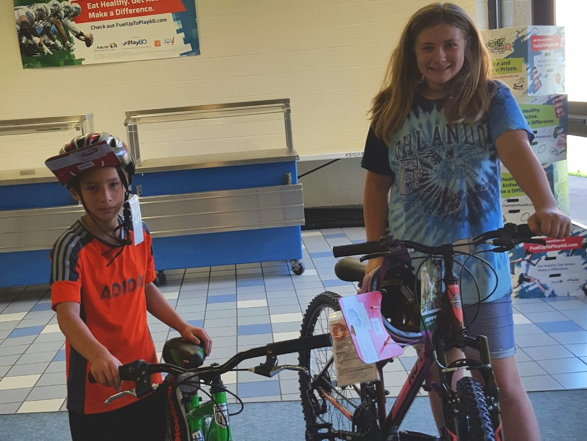 Summer Food Program bike winners Chris L. and Lexi P.!